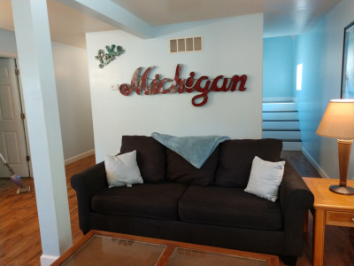 Duplex East Livingroom wall Lake Michigan sign.