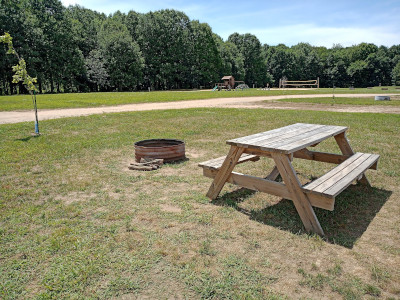 70 foot pull-through full hook-upsrv site, picnic table and fire pit