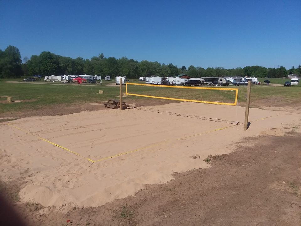 Beach volleyball, playground, park, horseshoe pit looking towards RV circle