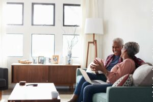 Seniors talking on the couch in their independent living apartment