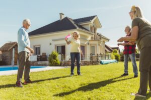 A group of seniors enjoy the summer weather with a game.
