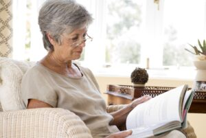 A senior woman reading and putting lifelong learning to use.
