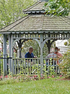 group of seniors gathered inside a gazebo