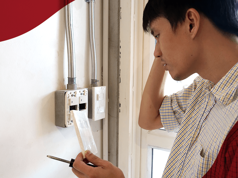 Man looking confused on how to fix his circuit board. Engage services on Carousell instead!