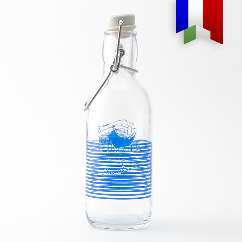 Une gourde en verre personnalisée au décor bleu «Pinasse Tchanqué». L'icône zéro plastique du Bassin d'Arcachon.