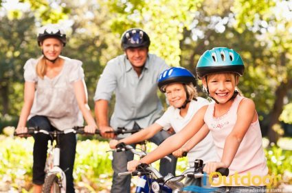 family wearing helmets on a bicycle