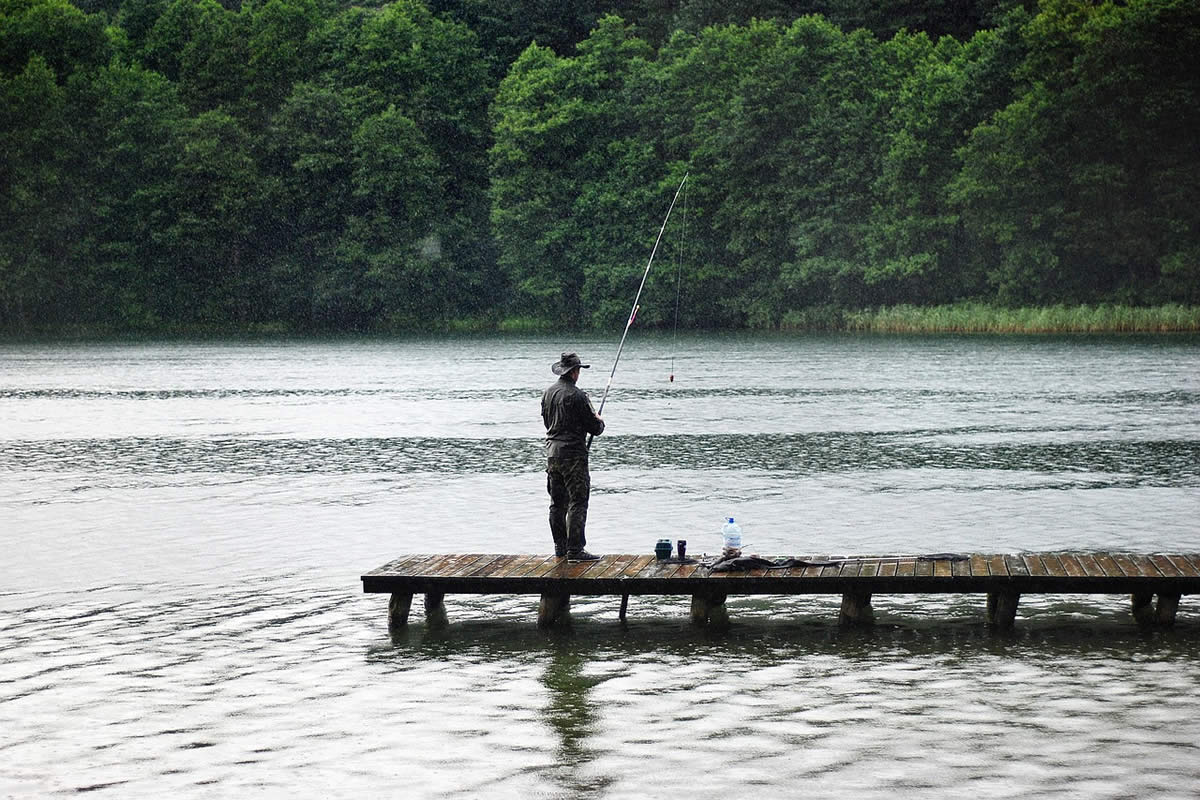 Fishing in the Rain from a Dock