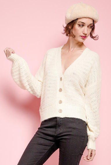 Perforated cardigan. The model measures 177 cm