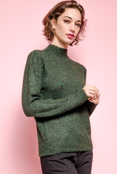 Shiny sweater. The model measures 177 cm