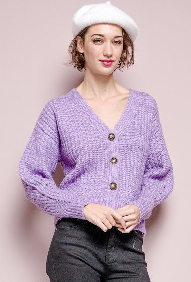 Ribbed knit cardigan. The model measures 177 cm