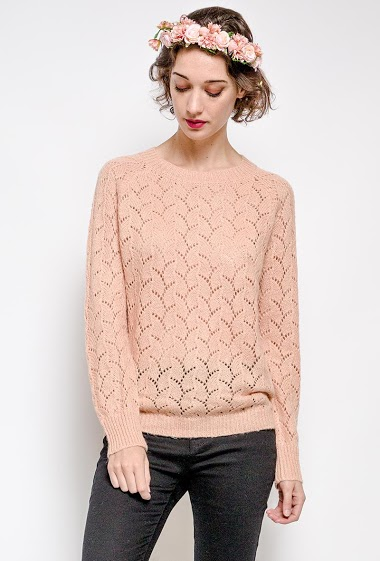 Shiny perforated sweater. The model measures 177 cm