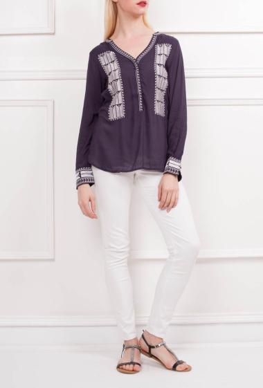 Top with metallized embroideries, V neck with buttons, long sleeves