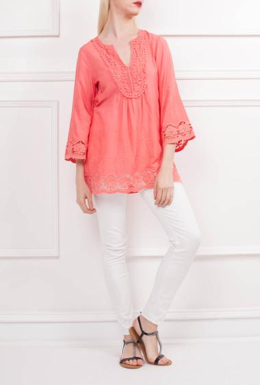 Top with V neck, crochet trim, smocks on the back, three-quarter sleeves