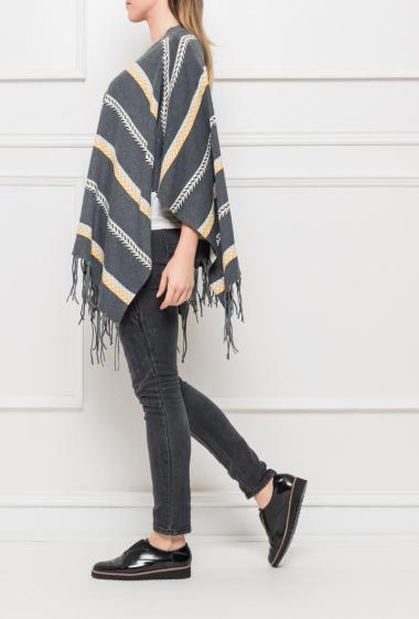 Poncho in knit with stripes, fringed hem