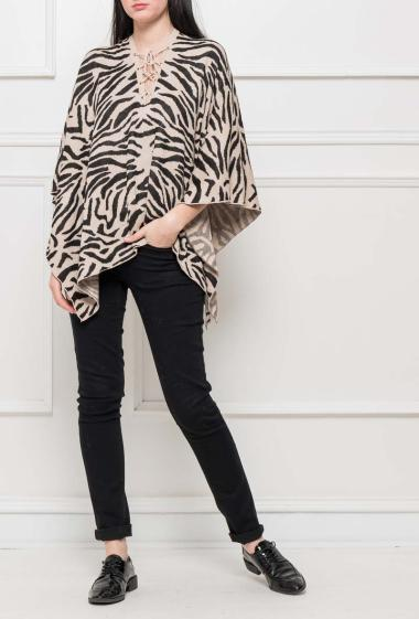 Bicolour knit poncho with zebra pattern, lace-up front
