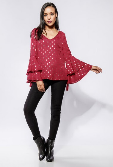 Printed blouse flared long sleeves, side with tie detail, regular fit, V back. The model measures 170cm and wears S/M