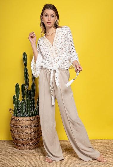 Lace off shoulder blouse, tassels. The model measures 170 cm