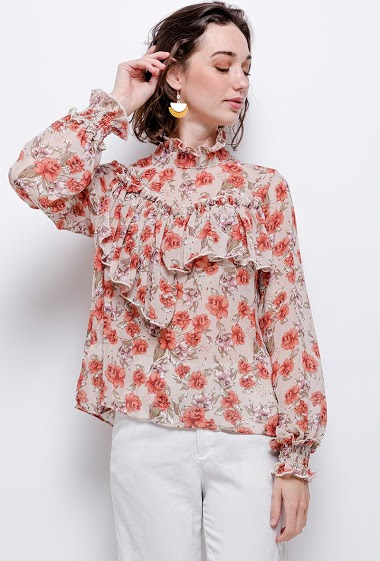 Blouse with printed flowers. The model measures 177cm