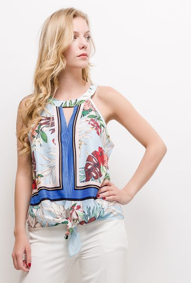 Knot sleeveless top with tropical print. The model measures 170cm and wears S/M. Length:60cm