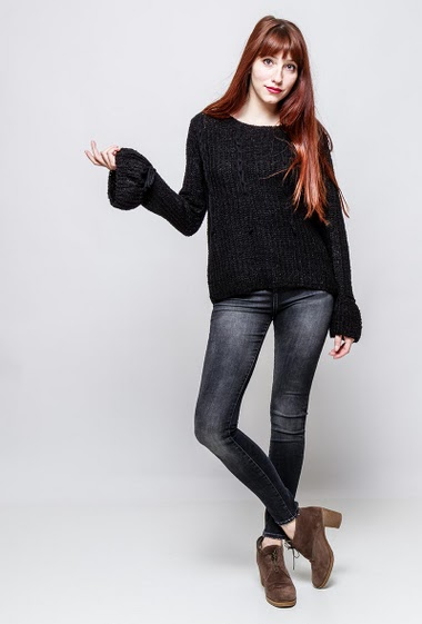 Knitted sweater with lace-up front, flared long sleeves. The model measures 174cm, one size corresponds to 38-40