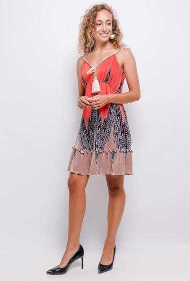 Printed dress. The model measures 171 cm