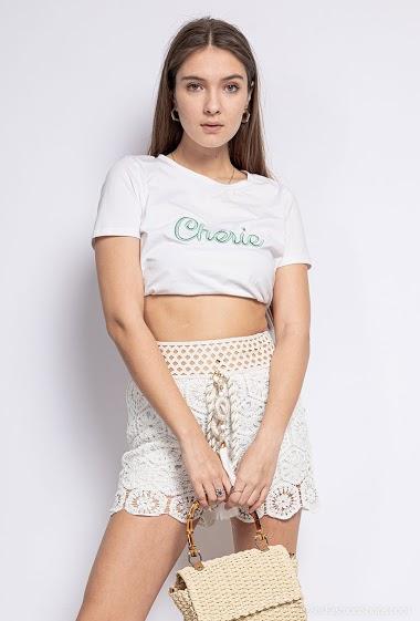 Crochet shorts. The model measures 172 cm