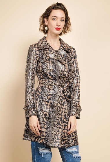 Varnished trench-coat, animal print. The model measures 177 cm