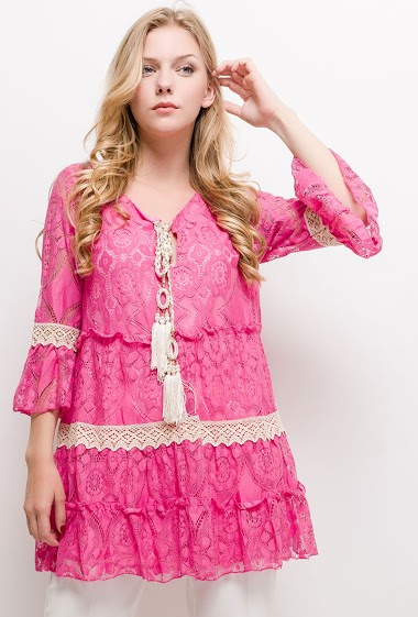 Flared bohemian tunic. The model measures 170cm and wears S/M. Length:75cm