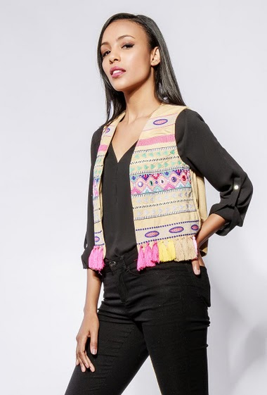 Suede jacket decorated with embroideries, mirror strass, tassels. The model measures 170cm and wears S