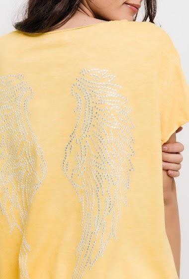 T-shirt à manches courtes. La mannequin mesure 176cm, TU correspond à 38/40. Longueur:65cm