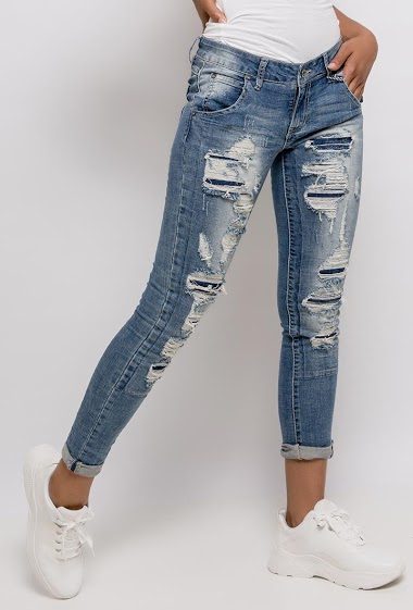 Slim jeans, rips. The model measures 170cm and wears S/8