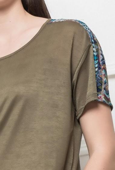 Short sleeves t-shirt, shoulders decorated with colorful embroideries, side slits, regular fit
