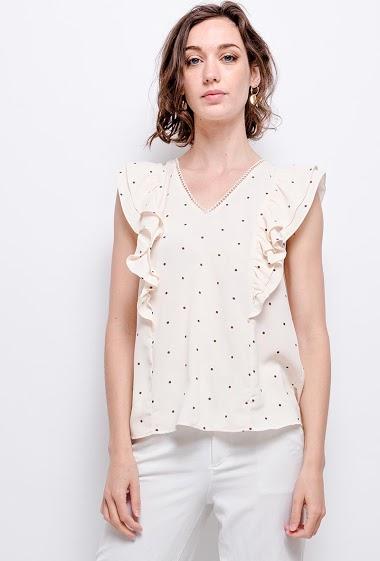 Ruffled blouse. The model measures 177 cm
