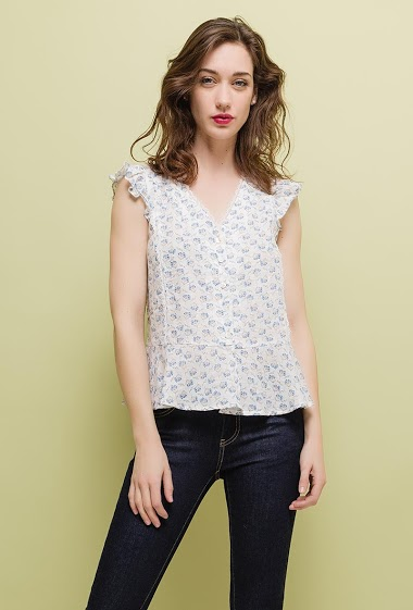 Sleeveless blouse, ruffles, printed flowers. The model measures 177cm and wears S. Length:55cm