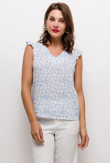 Blouse with ruffles, printed flowers. The model measures 175cm and wears S. Length:60cm