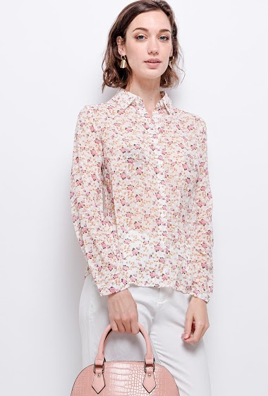 Shirt with flowers. The model measures 177 cm