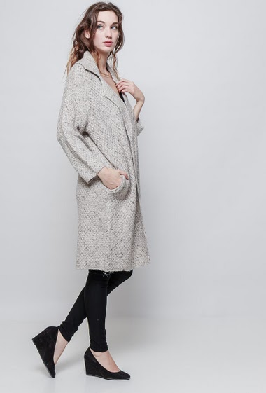 Knitted cardigan, pockets, open front, long and regular fit, thick touch. The mannequin measures 177 cm and wears S/M