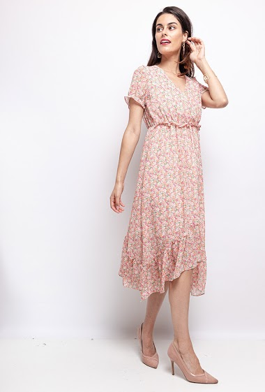 Dress with printed flowers. The model measures 176 cm