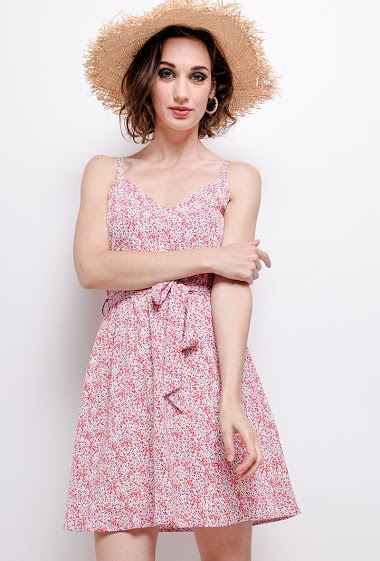 Dress with printed flowers, back with knot. The model measures 177 cm