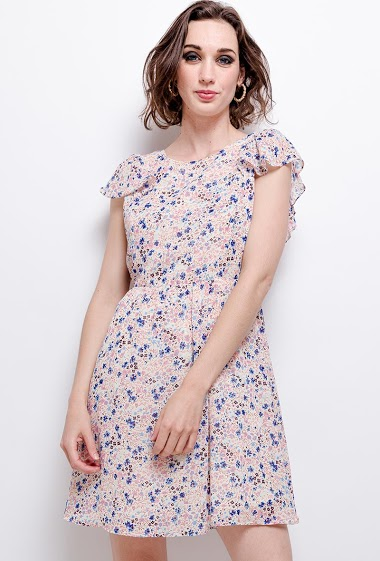 Dress with open back, printed flowers. The model measures 177 cm