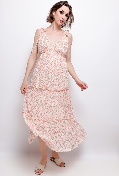 Maxi dress with knotted straps, printed flowers. The model measures 177 cm
