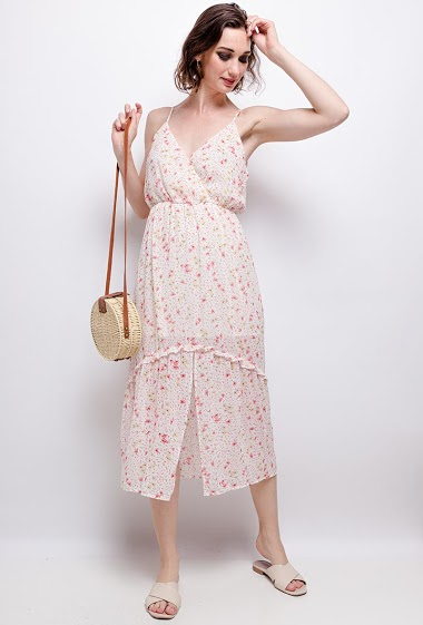 Midi dress with printed flowers. The model measures 177 cm