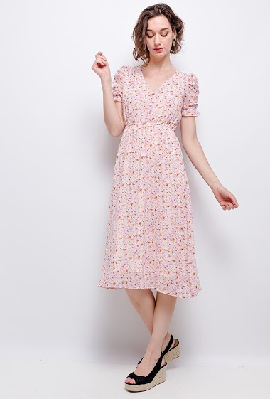 Dress with printed flowers. The model measures 177 cm