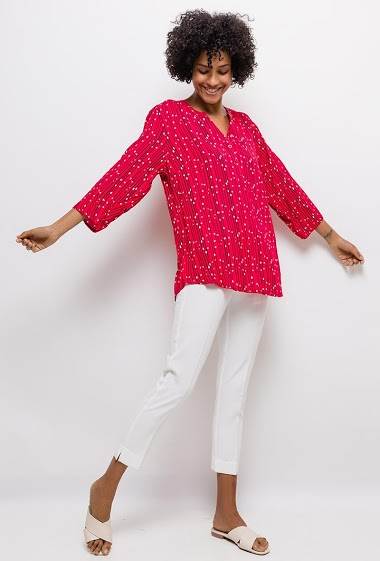 The model measures 177cm and wears T2=12/14(UK)40/42(FR). Length:75cm
