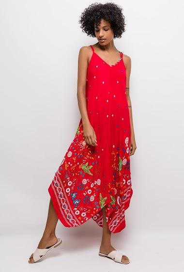 Strappy dress, asymmetric hem. The model measures 177cm and wears L. Length:115/135cm