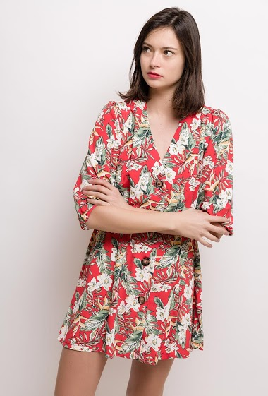 Dress with button, printed flowers. The model measures 178cm and wears S. Length:85cm