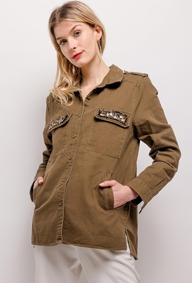 Jacket with rhinestones. The model measures 170cm and wears S. Length:70cm