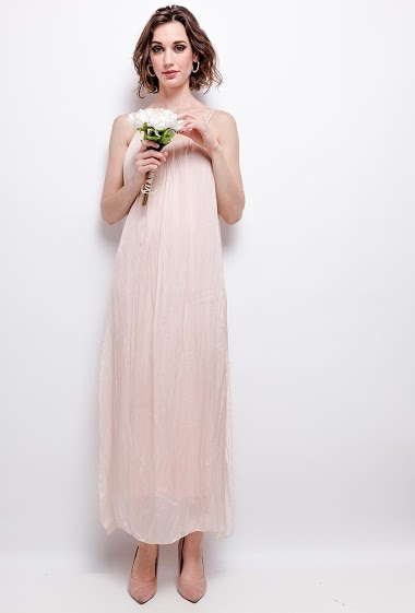 Dress with braided straps. The model measures 177 cm