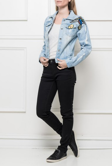 Faded denim jacket decorated with fancy embroideries, classic fit