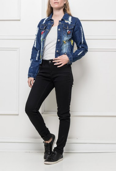 Faded denim jacket decorated with fancy patches, classic fit